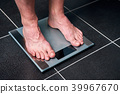 Male feet on the scale 39967670