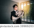 Portrait of teen musician playing instrument  39969203