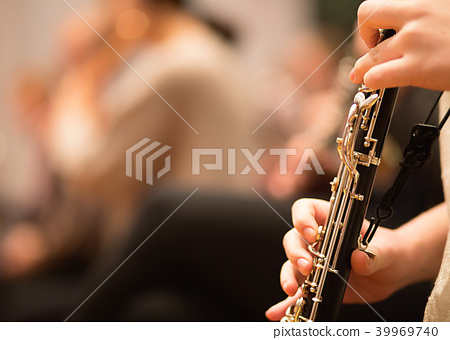 Oboe player performing in an orchestra 39969740