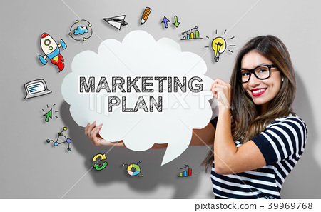 Marketing Plan text with woman holding a speech 39969768