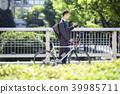 นักธุรกิจเดินทางไปปั่นจักรยาน 39985711