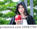 Young beautiful woman with red apple. 39987780