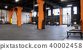 Spacious modern interior of the gym for fitness training 40002458