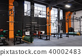 Interior of gym for fitness training with horizontal bar and barbells 40002483