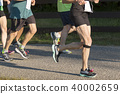 Runers racing a 5000 meter race in sunshine 40002659