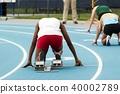 Sprinter in the starting blocks 40002789