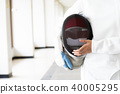 Close-up of a fencer in white fencing suit  40005295