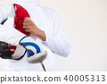 Close-up of a fencer in white fencing suit  40005313