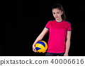 Indoor young volleyball woman player isolated on dark background 40006616