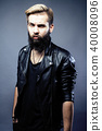portrait of young bearded hipster guy on gray dark background cl 40008096