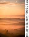 Picturesque sunrise misty Tuscany, Italy 40010418