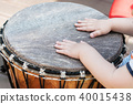 closeup of baby hands on african drums in outdoor 40015438