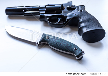 Black revolver with a drum and a knife. 40016480