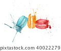 Three macarons with splashes 40022279