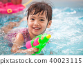 asian little child girl having fun to play water 40023115