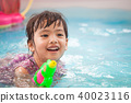 asian little child girl having fun to play water 40023116