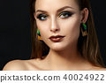 Portrait of young woman with beautiful makeup 40024922