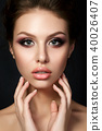 Young beautiful woman with evening make up 40026407