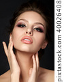Young beautiful woman with evening make up 40026408