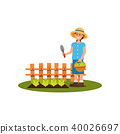 Farmer woman holding gardening spade and basket with harvest. Vegetable garden with green salad 40026697