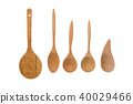 Old wooden spoons and stirrers on white background 40029466