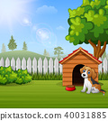 Cute dog sitting in front of a kennel in a garden 40031885