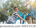 Young asian boy playing in playground 40033538