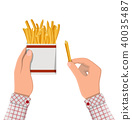 French fries in white paper box in hand 40035487