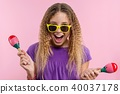 girl In bright yellow glasses she dances 40037178