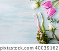 Two pastel toothbrushes with flowers herbs.  40039162