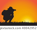 Silhouette of man using camera during sunset 40042952