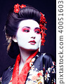 young pretty geisha in kimono with sakura and decoration on blac 40051603