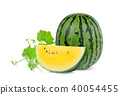whole and slice yellow watermelon with green leaf  40054455
