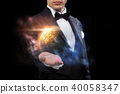 male magician with planet and space hologram 40058347