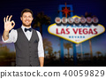 young man in suit showing ok sign at las vegas 40059829