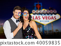 couple with party glasses having fun at las vegas 40059835
