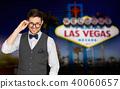 happy man in suit and eyeglasses at las vegas 40060657