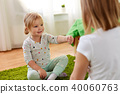 girls playing rock-paper-scissors game at home 40060763