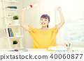 happy asian woman student with diploma at home 40060877