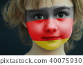 Child with a painted flag of Germany 40075930