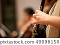 Oboe player performing in an orchestra 40096150