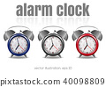 Multicolored alarm clocks on a white background. 40098809