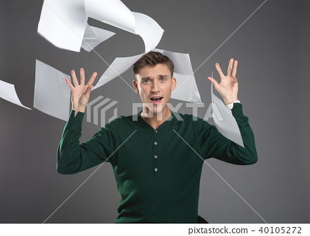 Unhappy male executive having paperwork done 40105272
