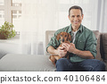 Positive owner and dog having fun at home 40106484