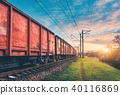 Red cargo wagons and train on railway station 40116869