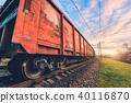 Red cargo wagons and train on railway station 40116870