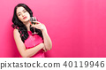 Young woman drinking wine on a solid background 40119946