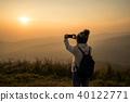 Young traveler taking photo beautiful sunset 40122771
