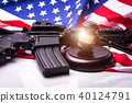 Gavel with gun on background of USA flag. 40124791