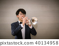 Musician jazz playing trumpet in studio room 40134958